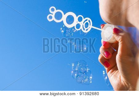 Female Person Blowing Soap Bubbles