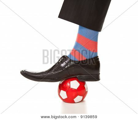 Man Leg In Suit With Soccer Ball And Stripped Socks
