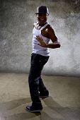 Muscular black man posing hip hop dance choreography on concrete background poster