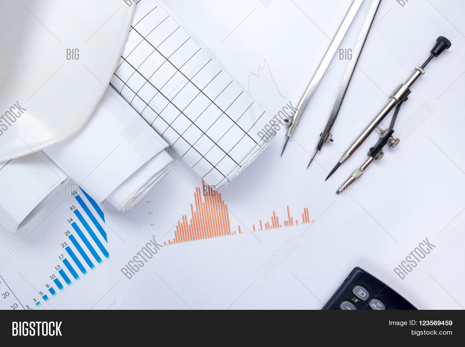Architectural image photo free trial bigstock architectural blueprints blueprint rolls compass divider calculator white safety on graph paper malvernweather Gallery