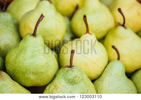 Green And Yellow Ripe Pears At A Farmers Market. Fruits Background
