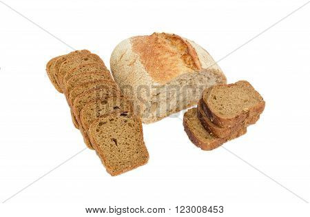 Half loaf of wheat unleavened bread with bran and sliced brown bread with whole grain on a light background