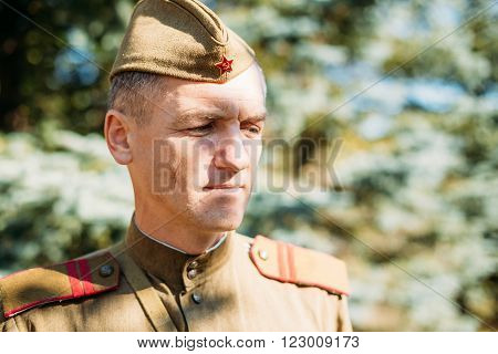 Teryuha, Belarus - October 3, 2015: Close up portrait of unidentified re-enactor dressed as World War II Soviet russian soldier in forest