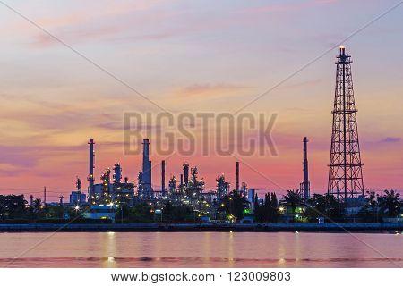 Distillation tank of oil refinery, twilight time.