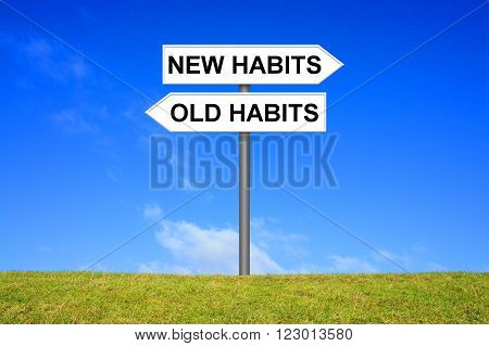 Signpost with 2 arrows shows New Habits or Old habbits