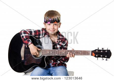 Boy Sitting And Playing With Guitar  Isolated On White Background