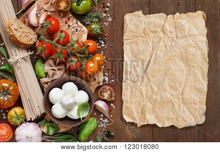 Italian cooking ingredients : mozzarella tomatoes garlic herbsl and other