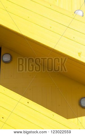 Modern yellow stairway exterior to a carpark poster