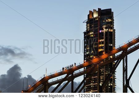 BRISBANE, AUSTRALIA - MARCH 3 2016: Brisbane City Story Bridge climbers close up during a sunset walk