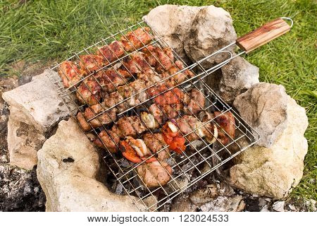Skewers Of Meat On The Grill Grate