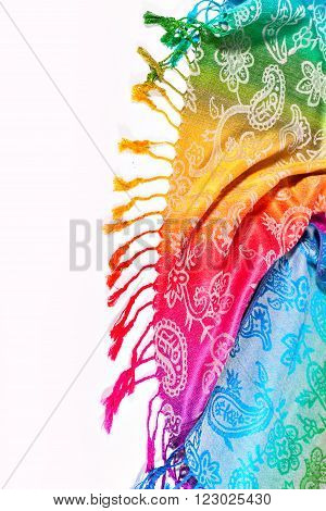 Colors of the rainbow bands on Indian fabric as a background. Brushes on the scarf. Rainbow gradient with a traditional pattern on stoles.  Isolation on a white background. The colors of the rainbow LGBT community. Symbol gay.
