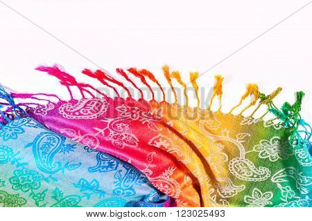 Colors of the rainbow bands on Indian fabric as a background. Rainbow gradient with a traditional pattern on stoles. Isolation on a white background. Brushes on the scarf. The colors of the rainbow LGBT community. Symbol gay.