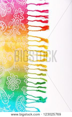 Colors of the rainbow bands on Indian fabric as a background.  Isolation on a white background. Rainbow gradient with a traditional pattern on stoles. Brushes on the scarf.The colors of the rainbow LGBT community. Symbol gay.