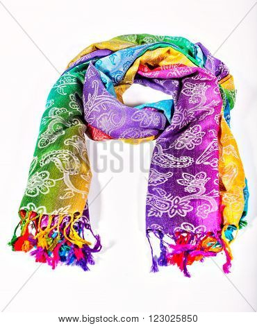 Colors of the rainbow bands on Indian fabric as a background. Rainbow gradient with a traditional pattern on stoles.  Isolation on a white background. Brushes on the scarf. Symbol gay.