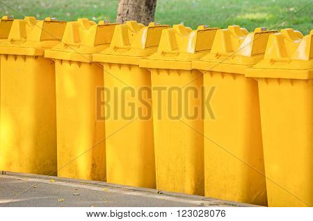 Yellow bins lined on walkway. About Cleanliness