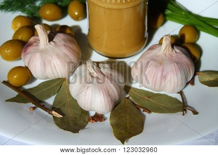 aroma pink heads of ripe garlic, mustard, olive, and verdure for cooking