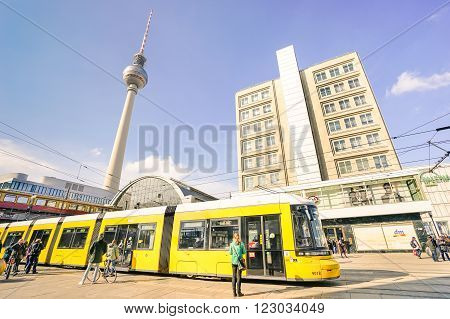 BERLIN GERMANY - 4 MARCH 2016: metro tram bus at Alexanderplatz in central Mitte district of european capital city with televison tower known as