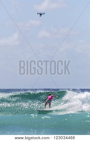 GOLD COAST, AUSTRALIA - MARCH 12 2016: Stephanie Gilmore (AUS) competing in the Roxy Pro at Snapper Rocks Coolangatta. WSL Drone hovering overhead
