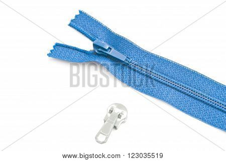 single blue zipper on white background closeup