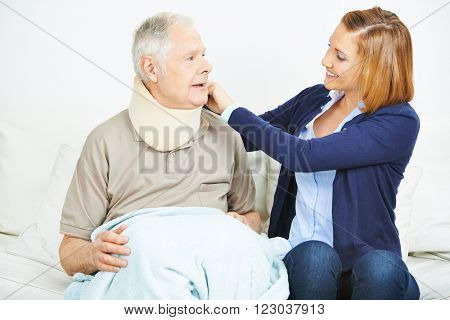 Nursing service checking ruff of senior man in nursing home