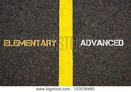 Antonym concept of ELEMENTARY versus ADVANCED written over tarmac road marking yellow paint separating line between words poster