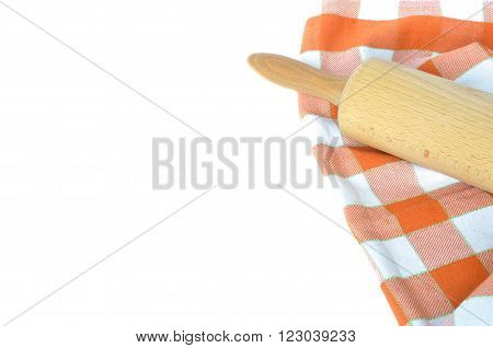 Orange white checkered dishcloth and rolling pin isolated on white