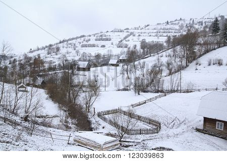 "authentic ukrainian village ""Kolochava"" at mountainside covered by snow in west Ukraine poster"