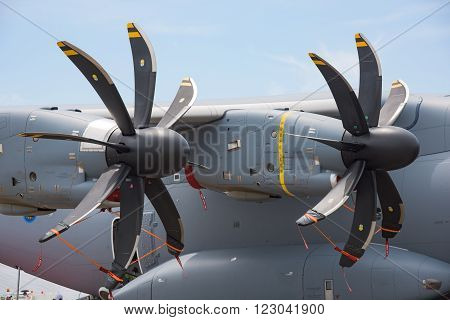 Singapore - February 17 2016: Engines and propellers of an Airbus A400M on display during Singapore Airshow at Changi Exhibition Centre in Singapore.