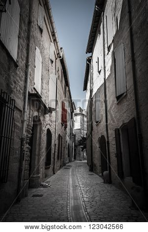Narrow street in France with typical buildings