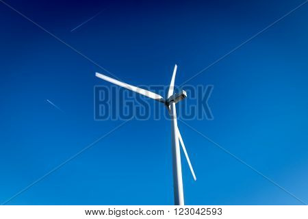 Windmill in a clear and blue sunny summer's sky