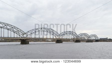 Railway bridge across the Daugava river in Riga Latvia.