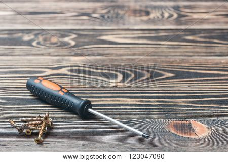 screw driver on a brown wooden matting