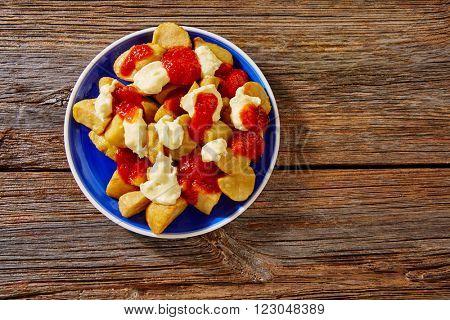 Tapas Patatas Bravas potatoe fries with tomato and mayonaise from Spain