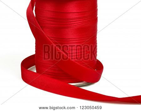 Golden and red bobbins of ribbons - edging, welt