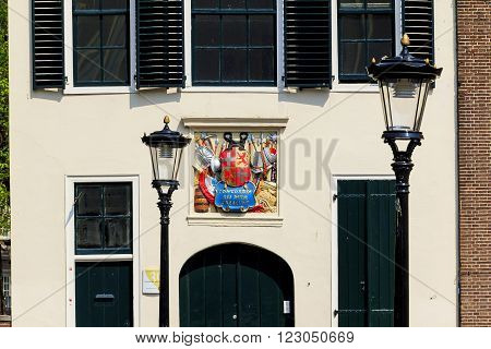 Utrecht, Netherlands - May 6: This monogram with the Latin adage and the coat of arms is a typical decoration of Dutch homes May 6, 2013 in Utrecht, Netherlands.