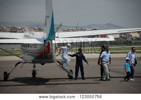 ANKARA/TURKEY-MAY 6: Passengers at the THK Etimesgut Airport during the demonstration flight with Cessna 206 Caravan aircraft. May 6, 2012-Ankara/Turkey