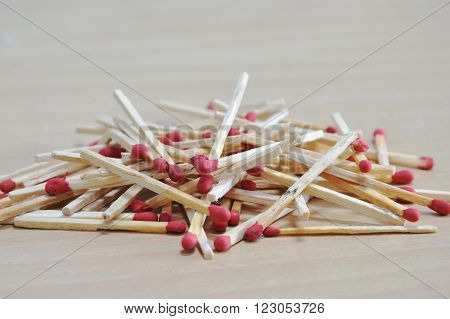 wooden matchstick batch arrange on the floor ** Note: Shallow depth of field