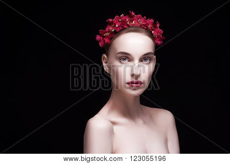 advertising image of a beautiful, well-groomed girl red wreath on his head, with open arms, looking at the camera