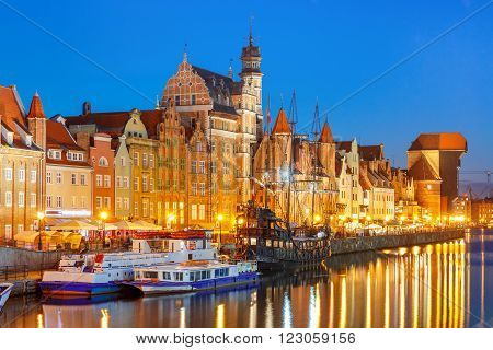 Tourist ships, Mariacka Gate and Zuraw in old town of Gdansk, Dlugie Pobrzeze and Motlawa River at night, Poland