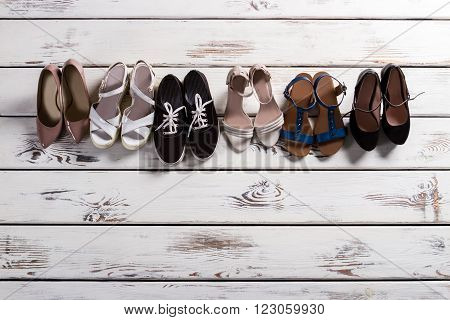 Leather heel shoes and keds. Footwear showcase at fashion store. Shoes sale in boutique. Lady's shoes for different occasions.