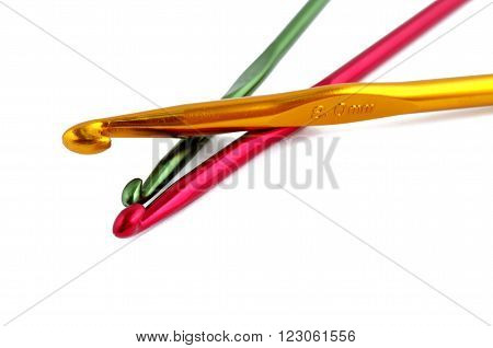 Multicolored crotchets of different size on white background