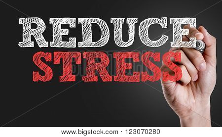 Hand writing the text: Reduce Stress