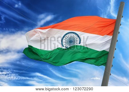 The Indian flag against the blue sky