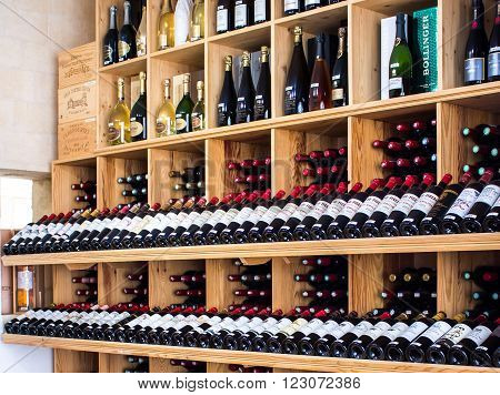 Saint Emilion FRANCE - APRIL 13 2015 - wooden racks with red wine bottles in a shop