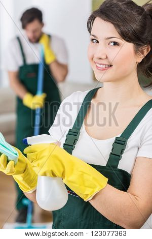 Young petty housekeeping woman ready to clean up the room