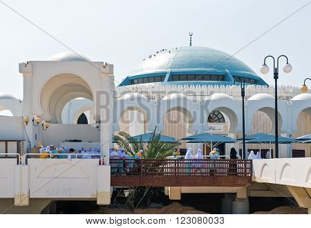 Jeddah, Saudi Arabia - November 20, 2008: Local people in the Sea Mosque on the Corniche area.