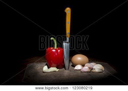 Knife, Mortar, Egg, Pepper And Garlic