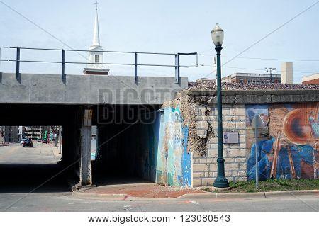 JOLIET, ILLINOIS / UNITED STATES - APRIL 12, 2015: Pedestrians and motorists may pass through the Van Buren Street Viaduct in downtown Joliet.