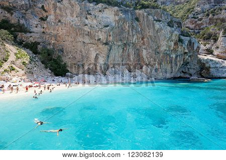 CALA MARIOLU BAUNEI ITALY - JULY 01 2015: People on one of the beautiful beach in Sardinia Italy