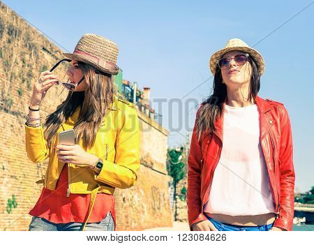 Attractive girlfriends in arrogant posing after couple discussion - Young women with serious face expression standing outdoor - Concept of human moods and modern relations - Main focus on left girl